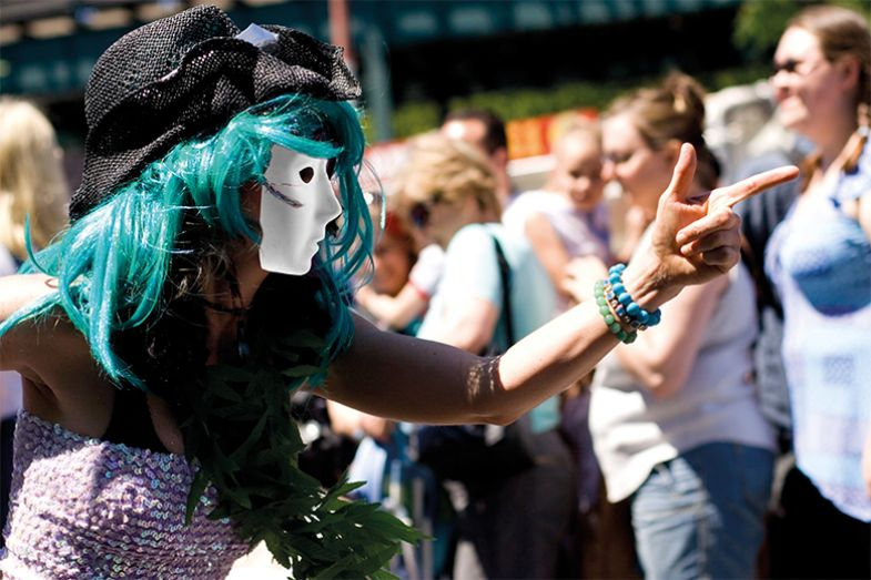 Person with green hair wearing mask