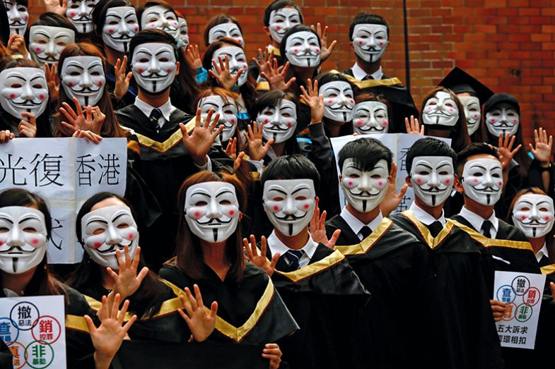 Hong Kong graduates wearing anonymous masks
