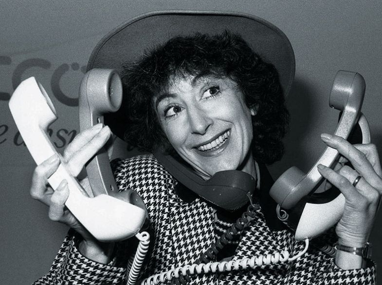 Maureen Lipman holding five telephones