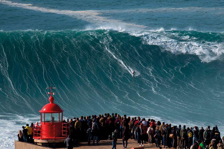 Brazilian surfer Rodrigo Koxa rides a wave in Nazare on November 20, 2019