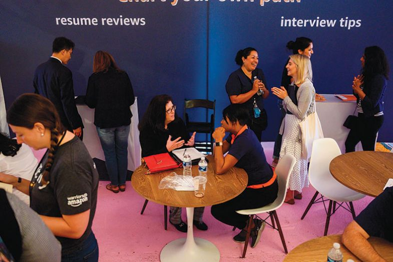 Job hunters speak with Amazon recruiters at an Amazon Career Day event
