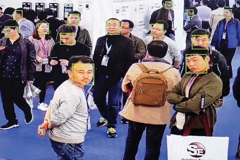 Visitors being filmed by AI security cameras with facial recognition technology at the 14th China International Exhibition on Public Safety and Security, Beijing