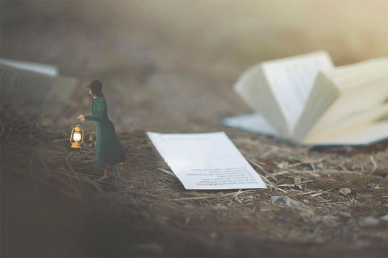 Miniature woman and book