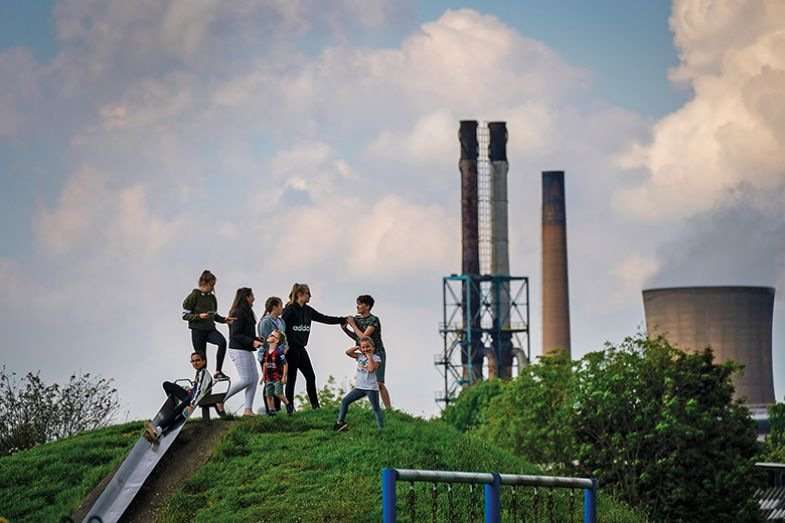 Children play in a park near British Steel's Scunthorpe works which was forced into liquidation in 2019