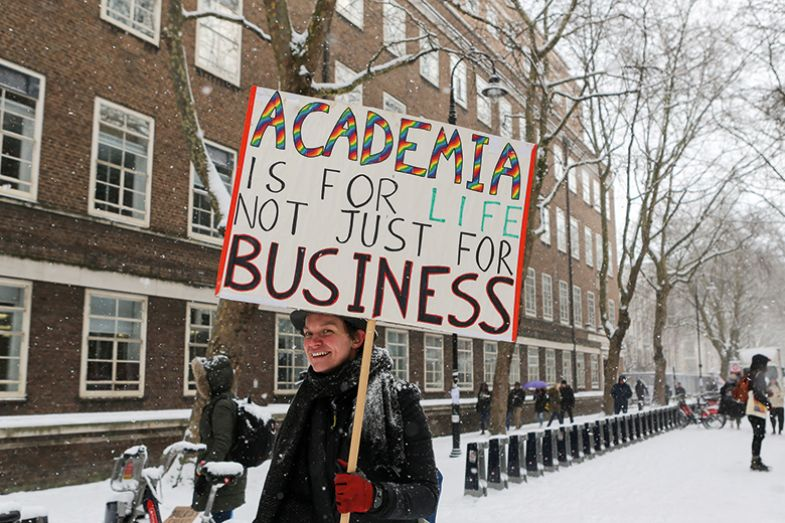 A university staff member protesting in the snow 2018
