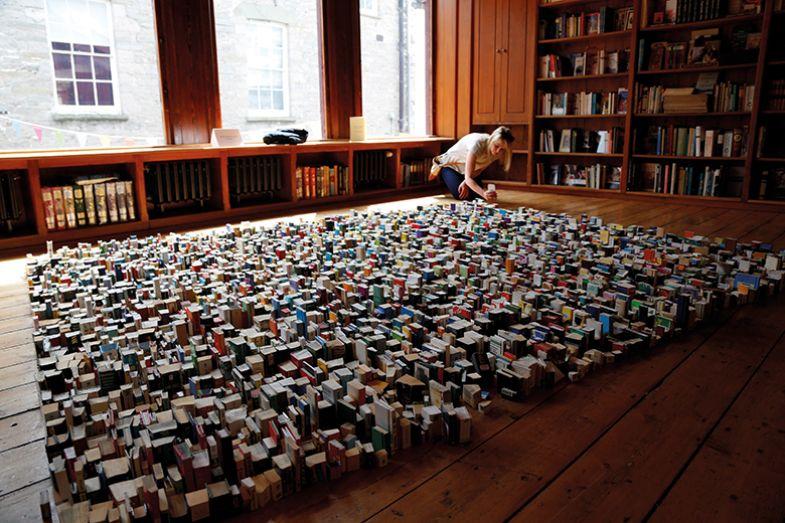 arranging books on floor