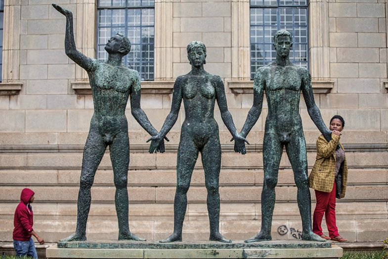 Sculpture of woman and two men