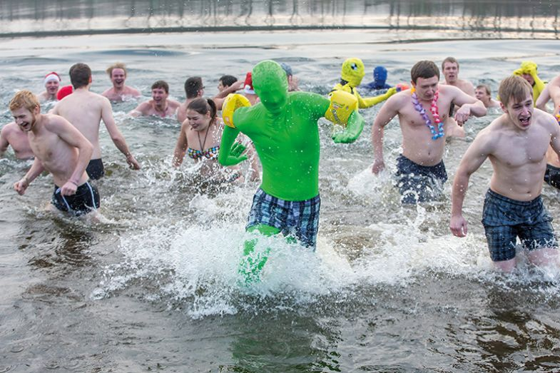 Man in green suit takes a swim