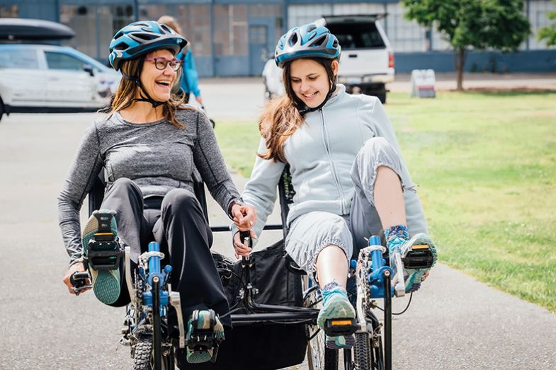 Mother and daughter on tandem bicycle