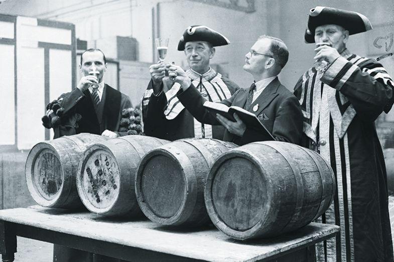 Four men tasting alcohol