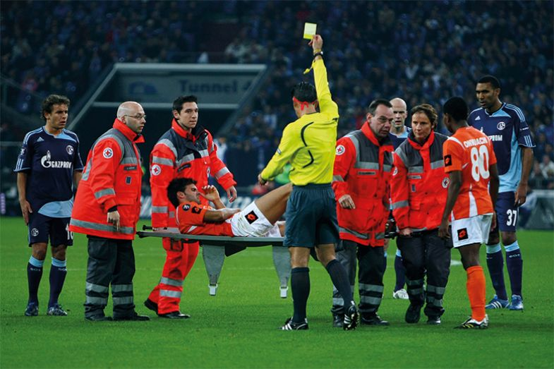Football ref giving yellow card