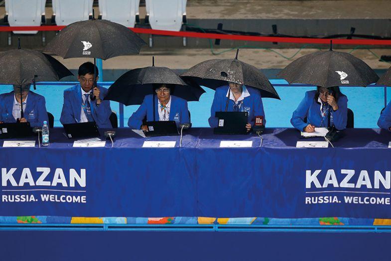 Sports judges under umbrellas