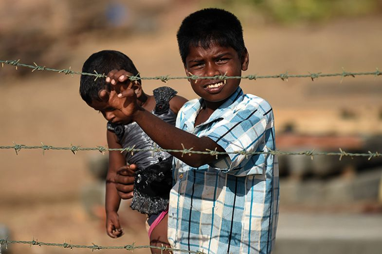 Children behind a barbed wire fence in Sri Lanka