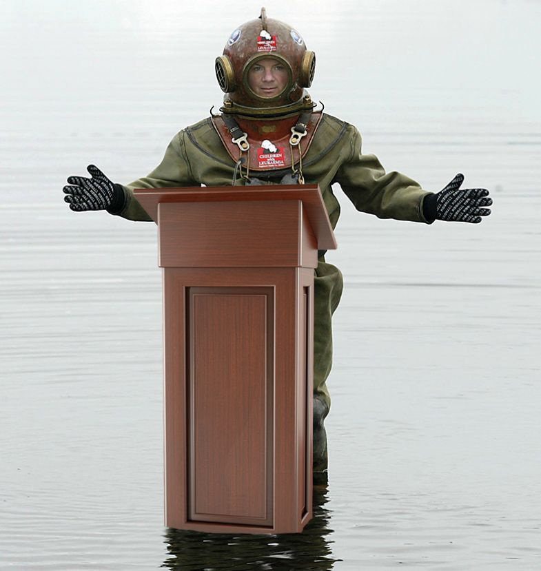 Diver at a lectern in water