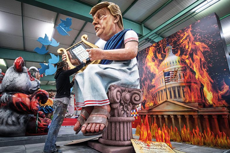 US President Donald Trump as the harp-playing Emperor Nero in front of a burning White House