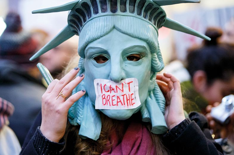 People demonstrate in London, England after grand juries decided not to indict the police officers involved in the death of Eric Garner in New York