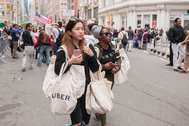 Woman carries Uber-branded bag