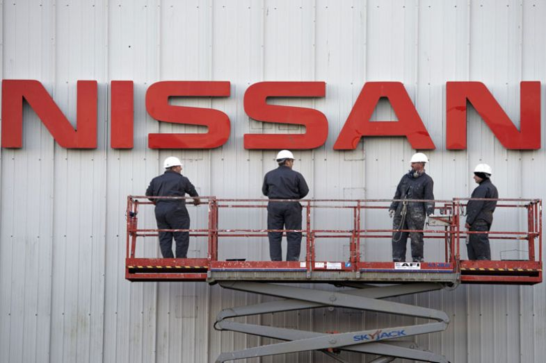 Workmen prepare to clean a large Nissan sign on the exterior of their Sunderland Plant in Sunderland