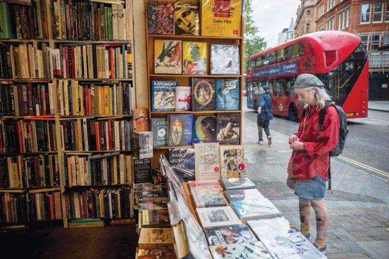 A woman looks at books in the window as a metaphor for feeling unemployed
