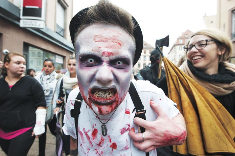 man dressed as a zombie takes part in a Zombie Walk for the book  John Smyth's Toxic University: Zombie Leadership, Academic Rock Stars, and Neoliberal Ideology