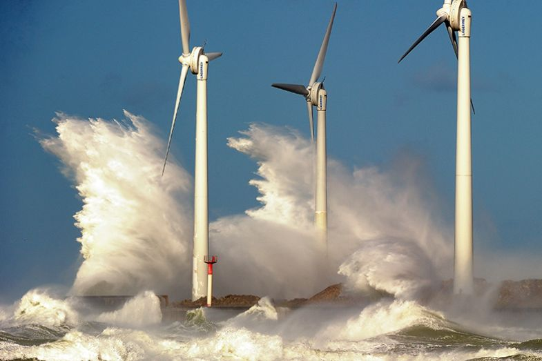 Waves break on a jetty holding wind turbines on November 2013 in the Channel port of Boulogne-sur-Mer, France