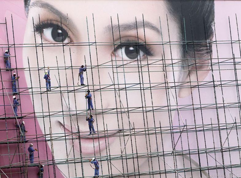 workmen scaffolding female face