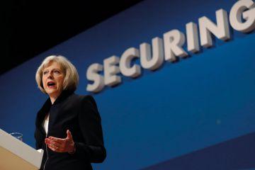 Theresa May speaking at podium
