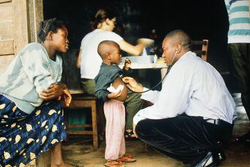Doctor examines young patient