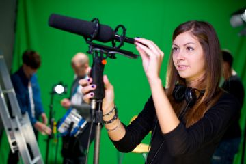 Apprentice journalist with microphone