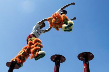 Chinese acrobatic performers jumping between poles