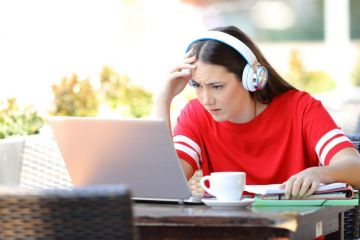 Confused student listens to online lecture