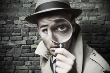 Private detective with magnifying glass
