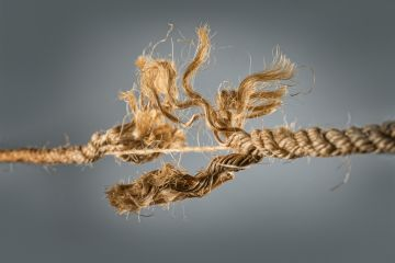 Frayed rope near to break