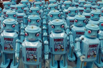 Group of blue robots facing camera