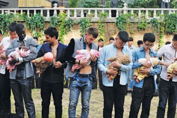 Group of men learning about breastfeeding