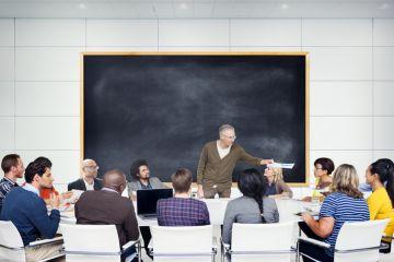 Students gathered around professor