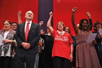 Labour Party leader Jeremy Corbyn on stage at conference