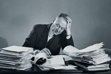 Man at desk marking