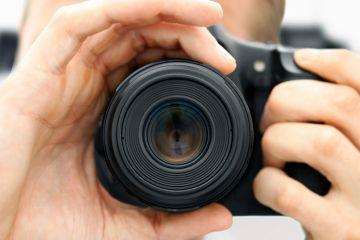 Man focussing camera lens