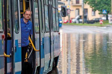 Man on tram stuck on flooded street, Wroclaw, Poland