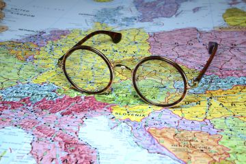 Glasses resting on a map