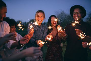 A group of millennials with sparklers