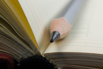 Pencil lying on open diary