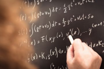 Physics teacher writing