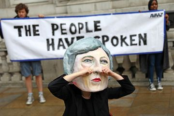 Protester in Theresa May mask