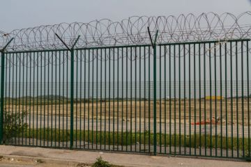Razor wire guarding ferry terminal in Calais, France
