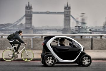Renault Twizy electric car and cyclist on London Bridge