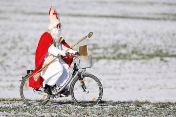 Saint Nicholas on a bike
