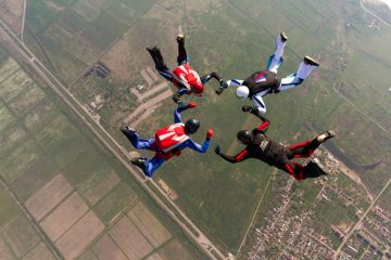 Four people skydiving