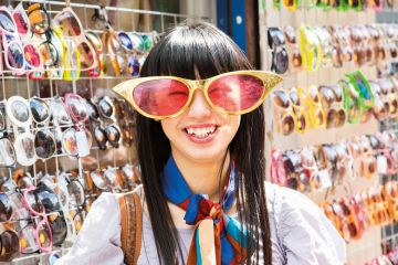 Smiling young woman wearing comedy sunglasses